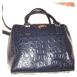 Textured navy blue handbag with crossbody strap